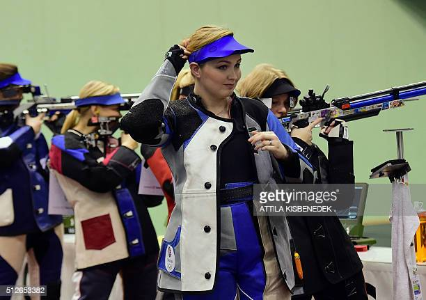 British Jannifer Mcintosh ajusts her hair prior to the qualification round of 10m air rifle category for women in AUDI Arena of Gyor on February 26...