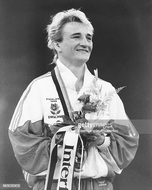 British judoka Karen Briggs stands on the podium after winning the judo 48kg gold medal at the Commonwealth Games in Auckland New Zealand January 1990