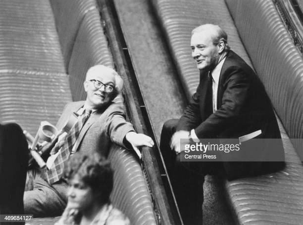 British Labour Leader of the Opposition Michael Foot with Labour MP Tony Benn in their seats at the House of Commons during the State opening of...