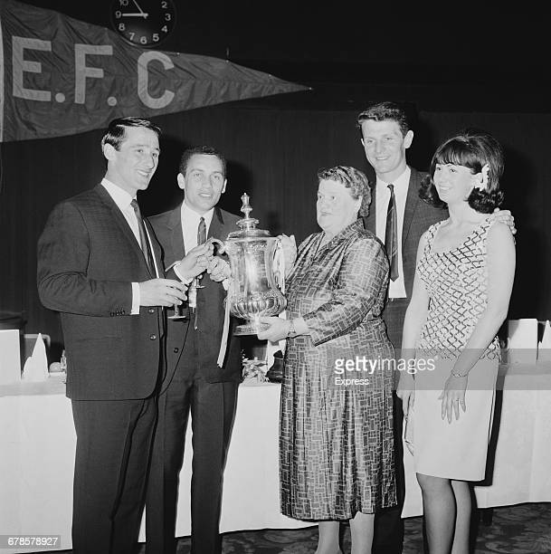 British Labour MP Bessie Braddock presents the FA Cup trophy to Everton FC footballers Derek Temple and Mike Trebilcock after they scored the two...