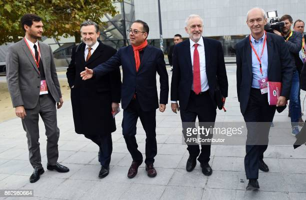 British Labour Party leader Jeremy Corbyn flanked by the president of the Socialists and Democrats Group in the European Parliament Gianni Pittella...