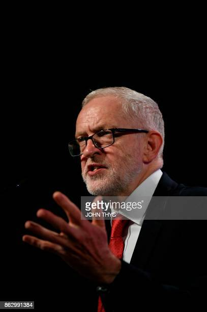 British Labour Party leader Jeremy Corbyn gestures as he speaks during a meeting of the Party of European Socialists in Brussels on October 19 2017...