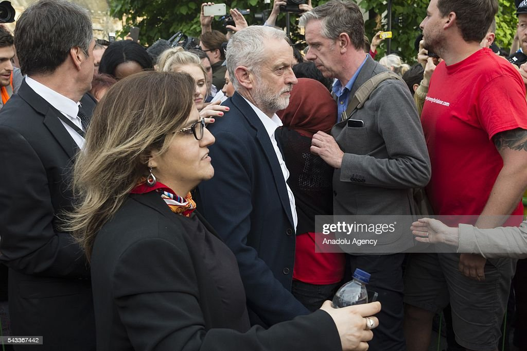 British Labour party leader Jeremy Corbyn (C) leaves a rally in Parliament Square organised by the Momemtum organisation to keep him as Labour party leader after the EU Referendum in London, United Kingdom on June 27, 2016