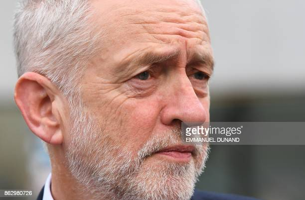 British Labour Party leader Jeremy Corbyn looks on as he arrives for a meeting of the Party of European Socialists in Brussels on October 19 2017 on...