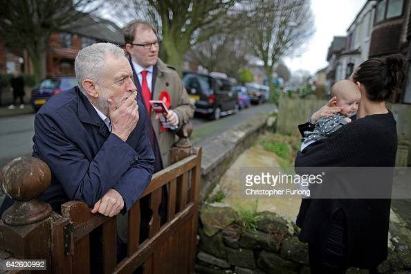 British Labour party leader Jeremy Corbyn meets Margot Dallimie aged 11 months and her mother Libby Wilkinson as he campaigns on the streets of...