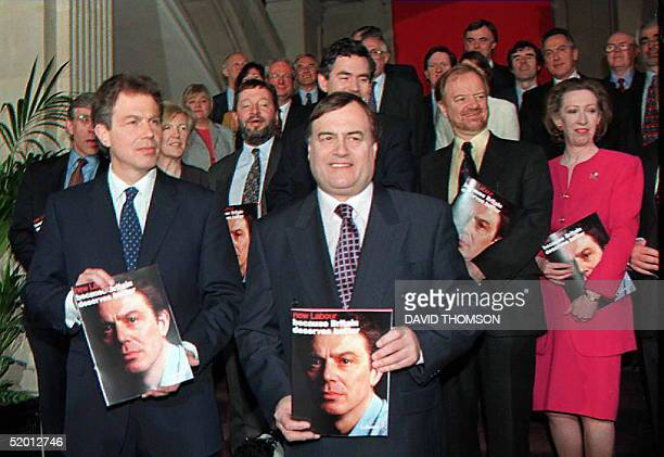 British Labour Party leader Tony Blair with deputy leader John Prescot and other members of the shadow cabinet hold copies of their new manifesto 03...