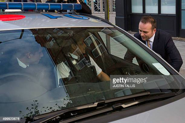 British Labour Party member of parliament Neil Coyle speaks to police officers parked outside to secure his constituency office in London on December...