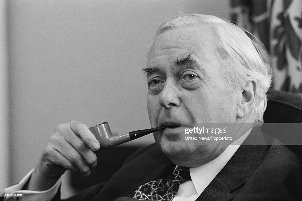 British Labour Party politician and ex Prime Minister, Harold Wilson (1916-1995) pictured holding a pipe during an interview on 26th November 1980.