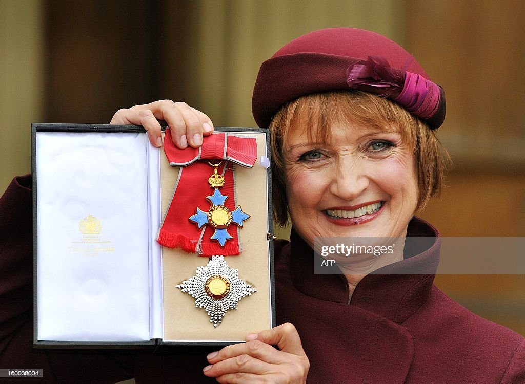 British Labour Party politician Tessa Jowell poses for a picture with her Dame Commander of the Order of the British Empire (DBE) insignia after it was presented to her by the Prince of Wales during the Investiture ceremony at Buckingham Palace in central London on January 25, 2013.