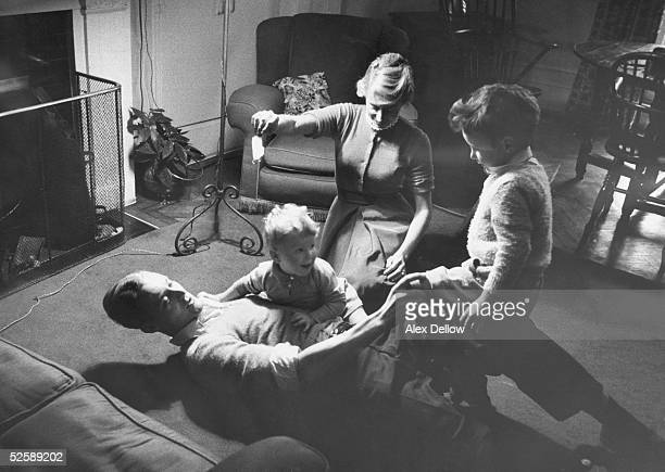 British Labour politician Tony Benn relaxes at home with his wife Caroline and children Hilary and Stephen 29th October 1955 Hilary later became MP...
