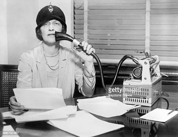 British Lady Astor member of the British Parliament and busy woman is using an electronic dictaphone circa 1930
