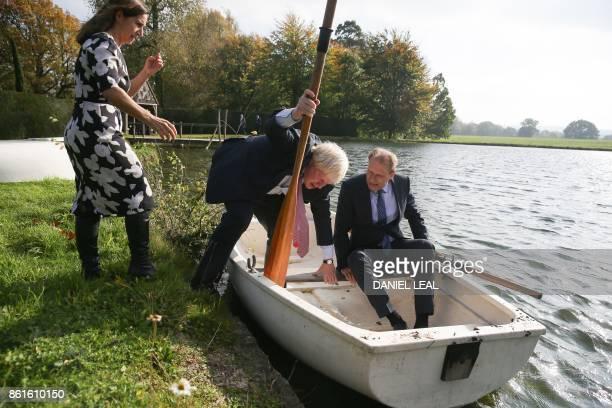 British lawyer and Boris Johnson's wife Marina Wheeler helps as Britain's Foreign Secretary Boris Johnson boards a row boat with Czech Republic's...