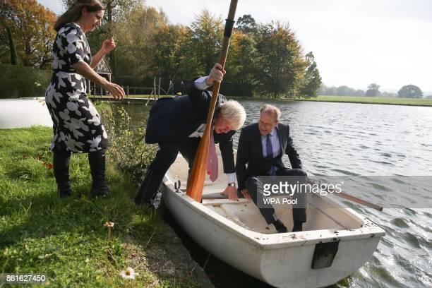 British lawyer Marina Wheeler helps her husband Britain's Foreign Secretary Boris Johnson and Czech Republic's Deputy Foreign Minister Ivo Sramek as...