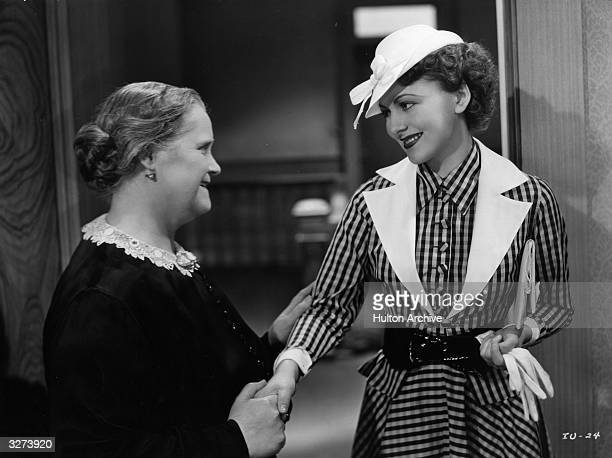 British leading lady Olivia De Havilland with Mary Gordon in a scene from the film 'The Irish in Us' directed by Lloyd Bacon for Warner Brothers Born...