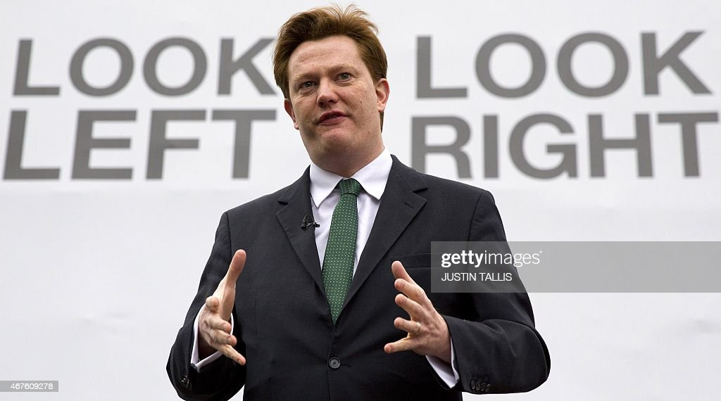 British Liberal Democrat MP and Chief Secretary to the Treasury Danny Alexander, poses for photographers as he launches a party campaign poster outside the Houses of Parliament in London on March 26, 2015, ahead of a general election on May 7, 2015.