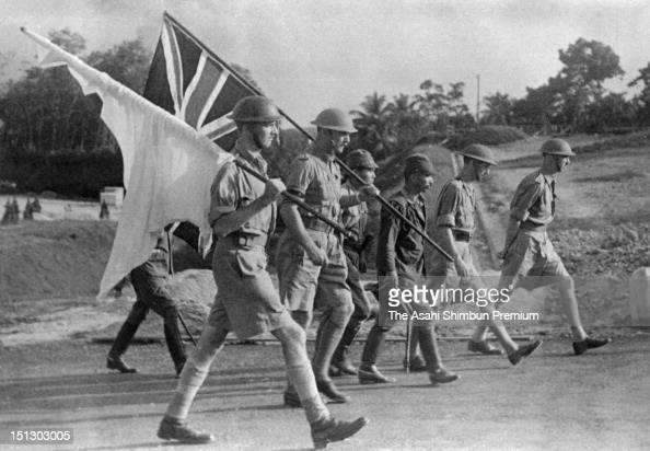 British Lieutenant General Arthur Ernest Percival General Officer Commanding Malaya in World War Two on march towards the Japanese camp to surrender...