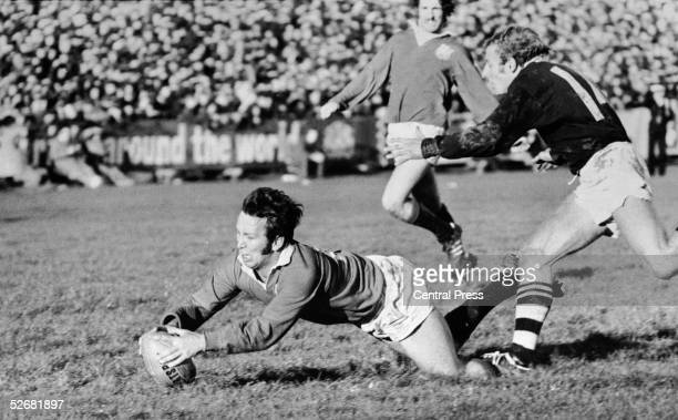 British Lions captain John Dawes gets over the line for a try despite the efforts of Otago winger Bruce Hunter 18th June 1971 The Lions beat Otago 219