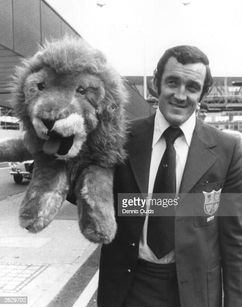 British Lions rugby team captain Phil Bennett holds a toy lion mascot at London Airport before leaving for a tour of New Zealand