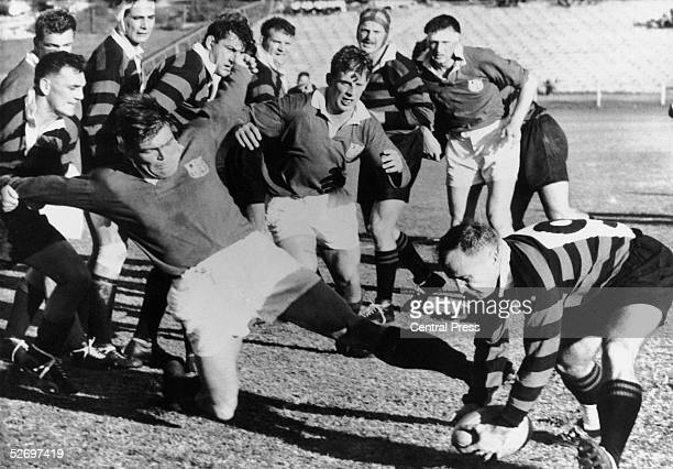 British Lions skipper Bryn Meredith attempting to get the ball away from scrum half Popeye Strydom during a game against Easter Province at the Boet...