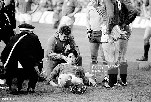 British Lions wing Roger Baird receives treatment for a neck injury from physio Kevin Murphy during the 4th Test Match against the All Blacks held at...