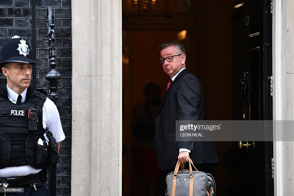 British Lord Chancellor and Justice Secretary Michael Gove (R) arrives to attend a cabinet meeting at 10 Downing Street in central London on June 27, 2016. European stock markets mostly slid Monday as British finance minister George Osborne attempted to calm jitters after last week's shock Brexit referendum. Britain's surprise referendum decision to leave the European Union wiped $2.1 trillion off market valuations on Friday and sent the pound collapsing to a 31-year low against the dollar. / AFP / LEON