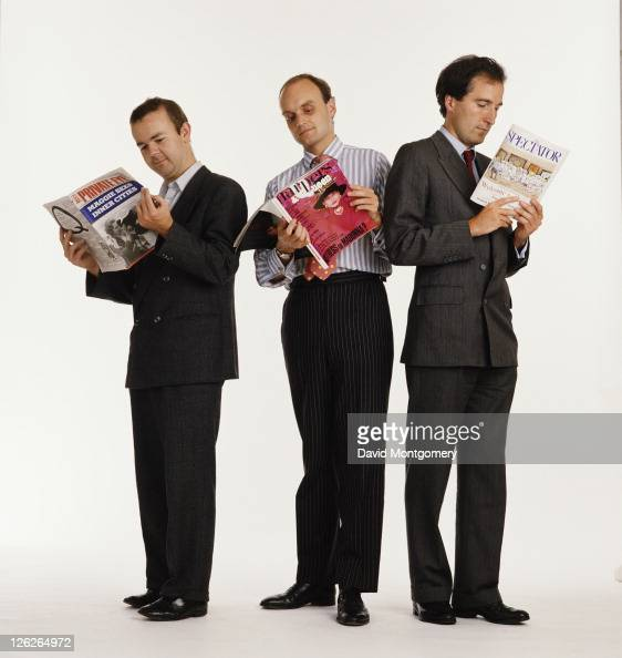 British magazine editors Ian Hislop Nicholas Coleridge and Charles Moore reading their respective publications Private Eye Harpers And Queen and The...