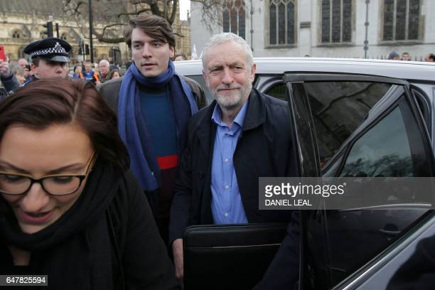 British main opposition Labour Party leader Jeremy Corbyn arrives to attend a rally against private companies' involvement in the National Health...