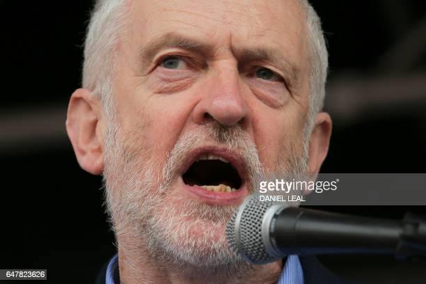 British main opposition Labour Party leader Jeremy Corbyn speaks at a rally against private companies' involvement in the National Health Service and...