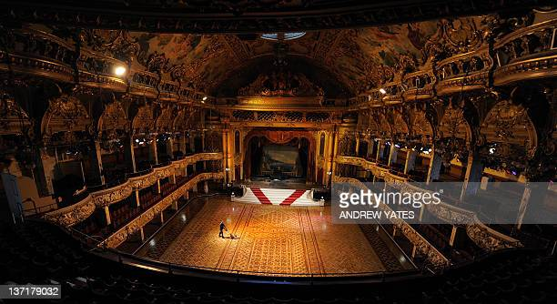 British maintenance engineer Darren Unsworth polishes the wooden floor during the annual cleaning of the ballroom in Blackpool Tower in Blackpool...