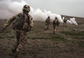 British Marines run towards a Taliban position during a British commando offensive on March 18 2007 near Kajaki in the Afghan province of Helmand...