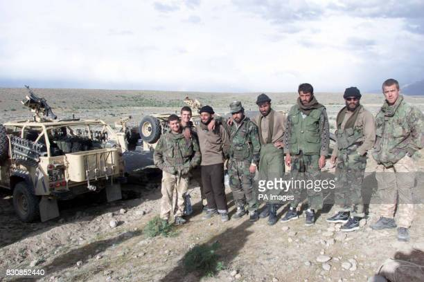British Marines working with Afghan troops supplied by a local warlord on patrol at Camp Taylor the Forward Operating Base as more than 1000 troops...