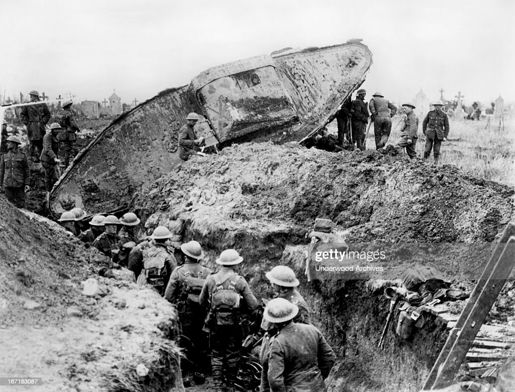 A British Mark II tank gets stuck crossing a captured communication trench Arras France April 1 1917 Infantry units are attempting to dig it out