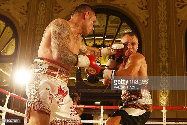 British Martin Murray fights against Ukraine's Max Bursak during their middleweight WBC boxing match on June 21 2014 in Monaco AFP PHOTO / VALERY...