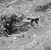 British Medical Services In The Second World War The Medical Chain of Evacuation An RAMC orderly makes his way forward under cover of the Red Cross...