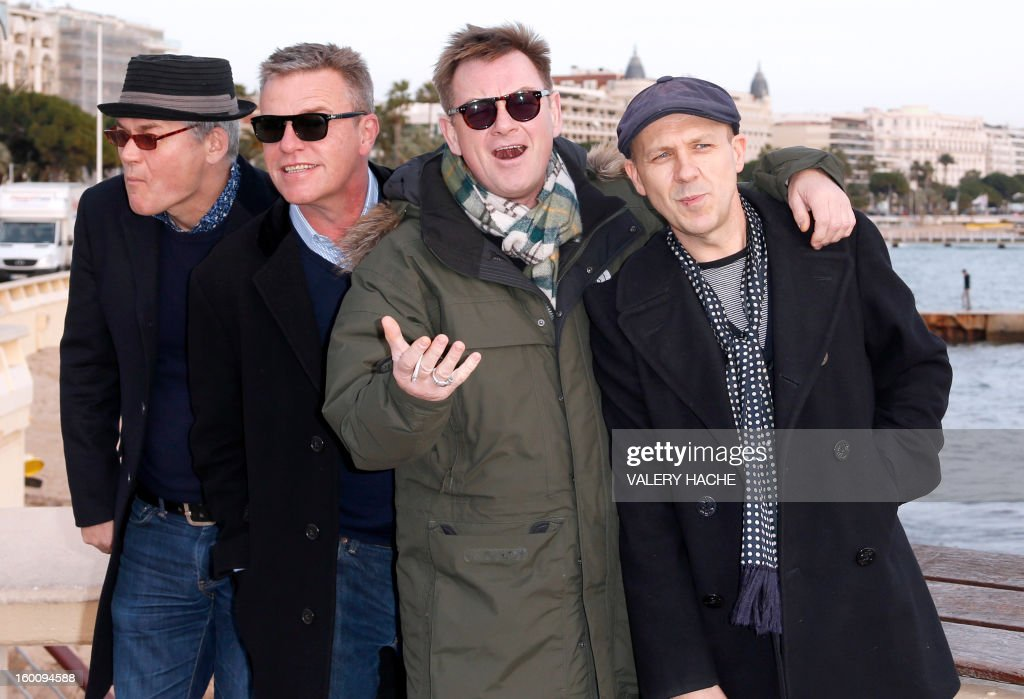 British members of 'Madness' music band, Lee Thompson, Chas Smash, Mike Barson and Chris Foreman pose during a photocall as part of the music world's largest annual trade fair, MIDEM on January 26, 2013 in Cannes, southeastern France. The MIDEM music trade show will bring 7,000 of the global industry's biggest players together on the French Riviera for four days. AFP PHOTO / VALERY HACHE