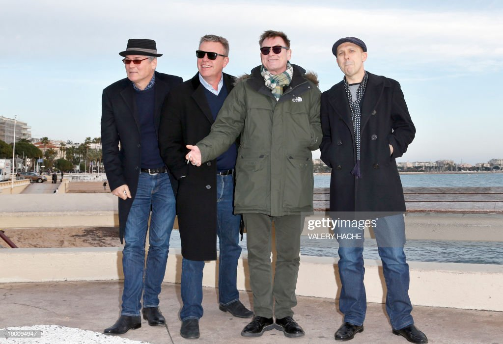 British members of 'Madness' music band, Lee Thompson, Chas Smash, Mike Barson and Chris Foreman pose during a photocall as part of the music world's largest annual trade fair, MIDEM on January 26, 2013 in Cannes, southeastern France. The MIDEM music trade show will bring 7,000 of the global industry's biggest players together on the French Riviera for four days.