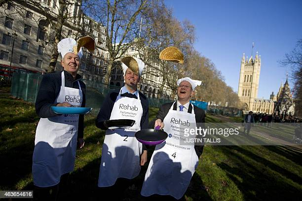 British members of parliament Nick de Bois David Burrowes and Andrew Rosindell practice flipping their pancakes as they take part in the annual...