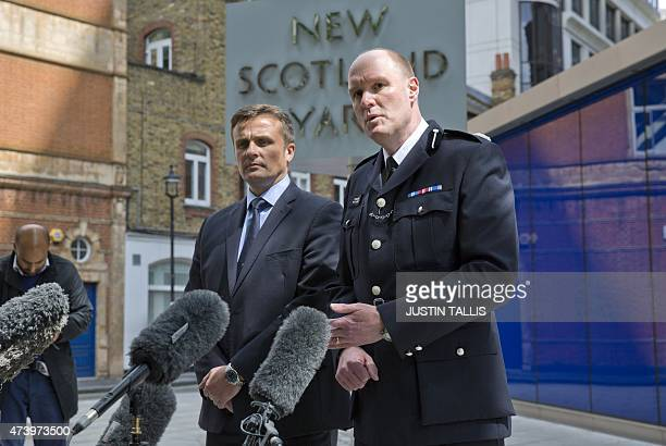 British Metropolitan Police's Detective Superintendent Craig Turner and Commander Peter Spindler speak to journalists during a news conference...