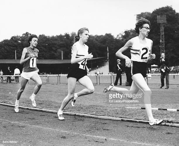 British middle distance runners Joy Jordan and Joyce Smith lead the field to finish first and second in the 800m race at a track and field meeting...