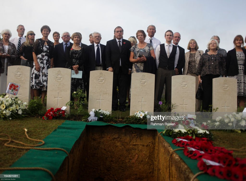 British military personnel, British high commissioner and family members attend the burial of eight RAF crew members at the Commonwealth War Cemetery on October 18, 2012 in Kuala Lumpur, Malaysia. The eight crew members were flying a B-24 Liberator on August 23, 1945, eight days after Japan surrendered in World War II, when the plane crashed and was lost near Kuala Pilah, Malaysia. The crash site was undiscovered until the 1990s and human remains were found in 2009 after a detailed investigation.