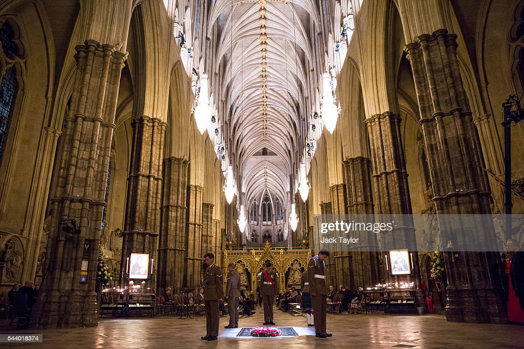 British Military personnel LBdr Walsh, LCpl Drury, LCpl Kinmond, Cpl Wolfe and Sgt Cohoon stand at the Grave of the Unknown Warrior during a vigil to commemorate the centenary of the Battle of the Somme at Westminster Abbey on July 1, 2016 in London, England. The overnight vigil is being held to remember those who died in the Battle of the Somme which began 100 years ago on July 1st 1916. Armies of British and French soldiers fought against the German Empire and over one million lives were lost. The Grave of the Unknown Warrior contains the body of an unidentified British solider from the First World War buried in French soil and covered with a Belgian marble slab.