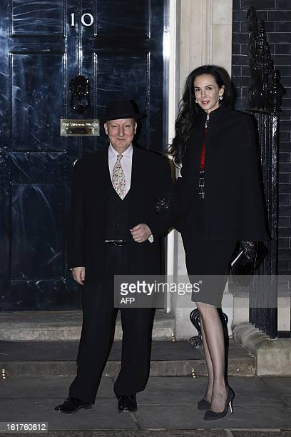 British milliner Stephen Jones and US fashion designer L'wren Scott pose for photographers as they arrive at Number 10 Downing Street for a reception...