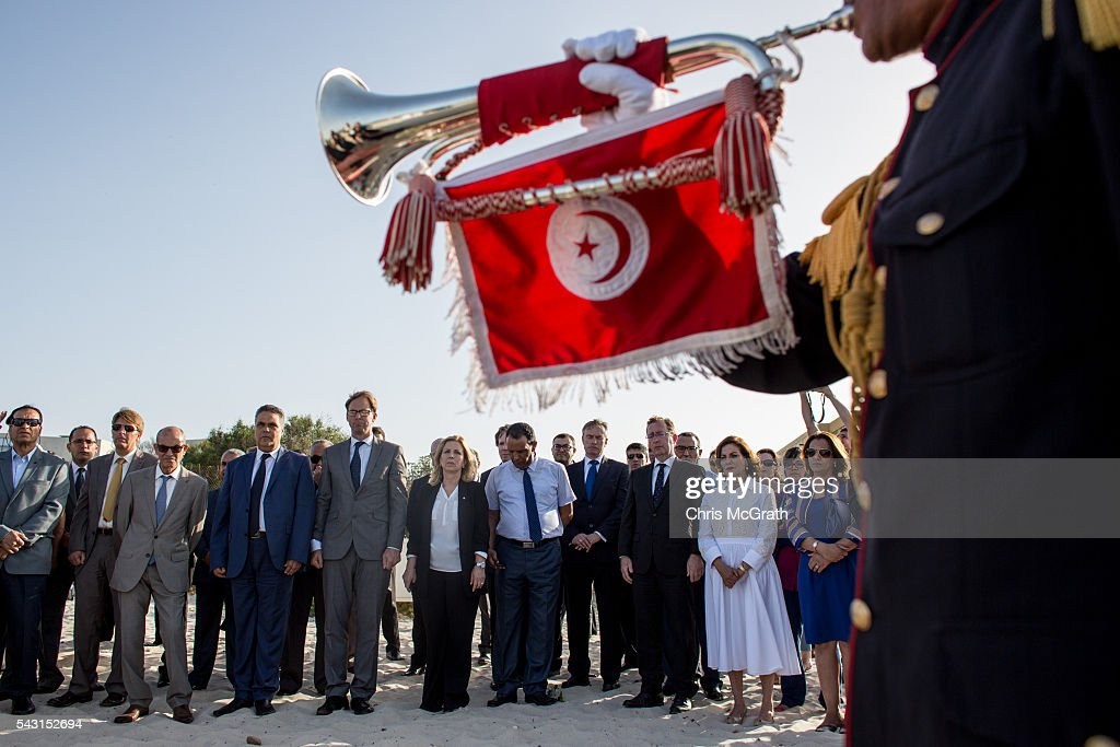 British Minister for North Africa Tobias Ellwood (6th-L) and other officials pay their respects to the victims of the 2015 Sousse Beach terrorist attack during a minutes silence on the beach in front of the Imperial Marhaba hotel on June 26, 2016 in Sousse, Tunisia. Today marks the one year anniversary of the Sousse Beach terrorist attack, which killed 38 people including 30 Britons. Before the 2011 revolution, tourism in Tunisia accounted for approximately 7% of the countries GDP. The two 2015 terrorist attacks at the Bardo Museum and Sousse Beach saw tourism numbers plummet even further forcing hotels to close and many tourism and hospitality workers to lose their jobs.