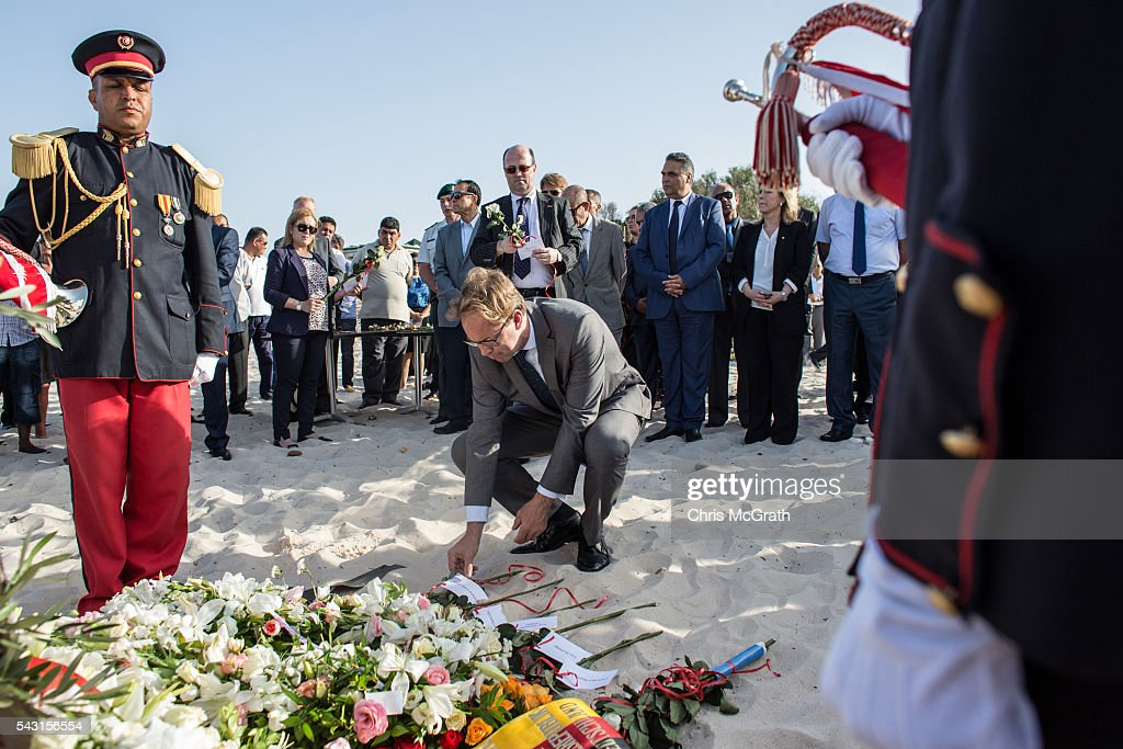 British Minister for North Africa Tobias Ellwood lays a rose for each of the 30 British victims of the 2015 Sousse Beach terrorist attack during a memorial service on the beach in front of the Imperial Marhaba hotel on June 26, 2016 in Sousse, Tunisia. Today marks the one year anniversary of the Sousse Beach terrorist attack, which killed 38 people including 30 Britons. Before the 2011 revolution, tourism in Tunisia accounted for approximately 7% of the countries GDP. The two 2015 terrorist attacks at the Bardo Museum and Sousse Beach saw tourism numbers plummet even further forcing hotels to close and many tourism and hospitality workers to lose their jobs.