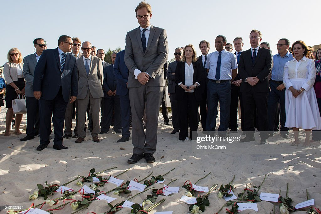 British Minister for North Africa Tobias Ellwood pays his respects to the 30 British victims of the 2015 Sousse Beach terrorist attack during a memorial service on the beach in front of the Imperial Marhaba hotel on June 26, 2016 in Sousse, Tunisia. Today marks the one year anniversary of the Sousse Beach terrorist attack, which killed 38 people including 30 Britons. Before the 2011 revolution, tourism in Tunisia accounted for approximately 7% of the countries GDP. The two 2015 terrorist attacks at the Bardo Museum and Sousse Beach saw tourism numbers plummet even further forcing hotels to close and many tourism and hospitality workers to lose their jobs.
