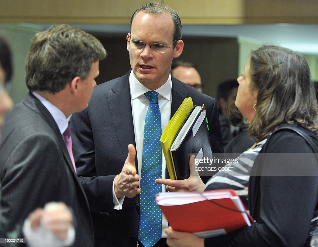 British minister for the natural environment and fisheries Richard Benyan, Irish agriculture marine and food minister Simon Coveney and Danish agriculture Minister Mette Gjerskov speak together at the beginning of an European Union's Agriculture ministers meeting, on January 28, 2013 at the EU Headquarters in Brussels. The Council will hold an exchange of views on the Irish presidency's work programme for the reform of the Common Fisheries Policy (CFP) and on the key issues requiring further discussion in this context, following the general approaches reached last year by the Council on the CFP reform proposals.