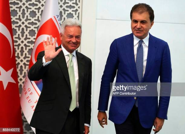 British minister of state for Europe and Americas Alan Duncan gestures next to Turkish Minister for European Union Affairs Omer Celik after a joint...