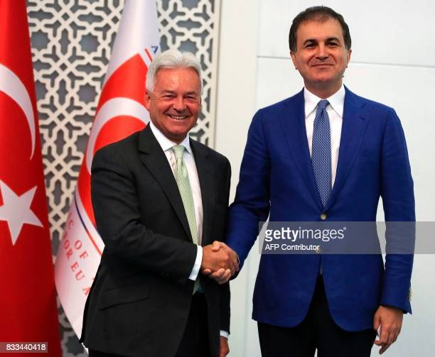British minister of state for Europe and Americas Alan Duncan shakes hands with Turkish Minister for European Union Affairs Omer Celik after a joint...