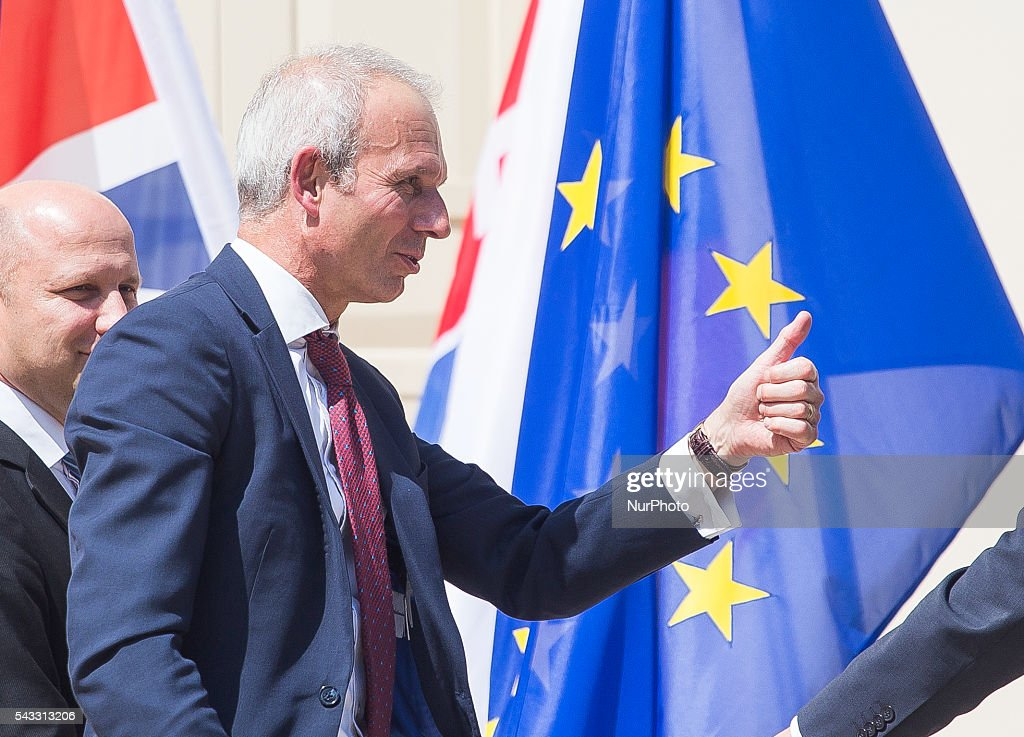 British Minister of State for Europe David Lidington gets thumbs up on a background of the European Union flag after meeting of foreign ministers and officials of several EU countries, in Warsaw, 27 June, 2016, Poland