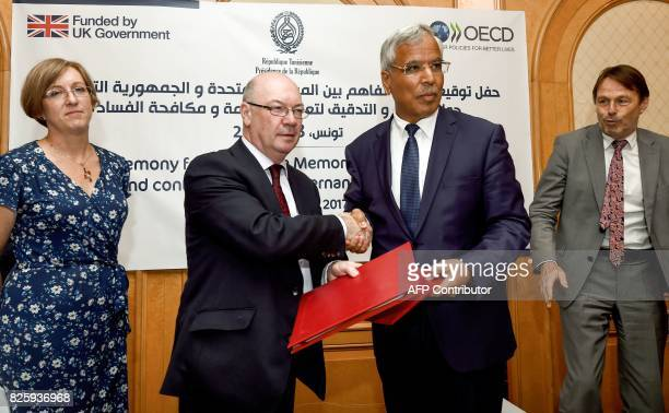 British minister of state for the Middle East and North Africa Alistair Burt exchanges a signed memorandum of understanding on audit and control for...